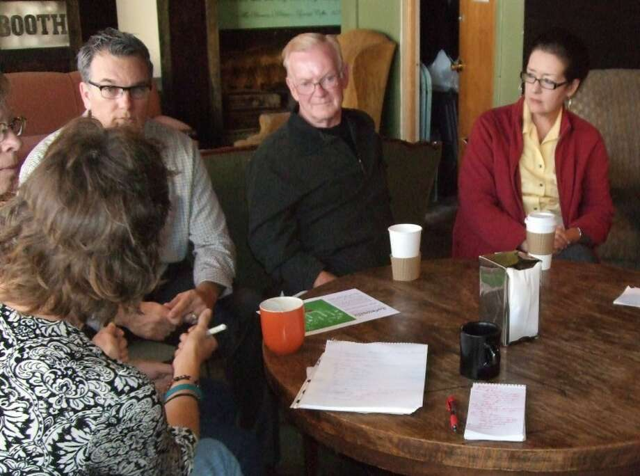 Individuals and members of various organizations met Wednesday to discuss future Artwalks. Among those attending are Sally Gubser (left), Rick Davis, Joe Provence and Dr. Candace Keller. Photo: Gail M. Williams | Plainview Herald