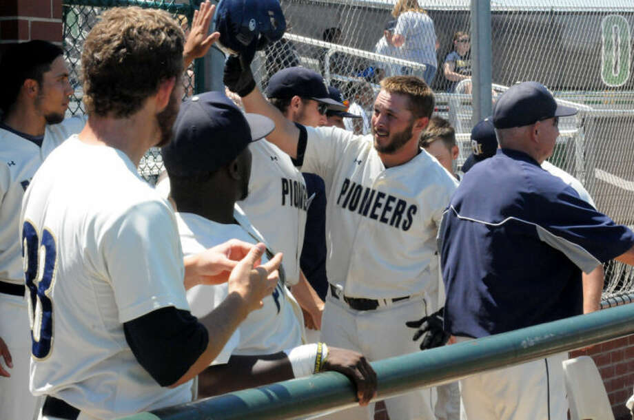 Brayden Blackwell (center) is greeted by teammates in the dugout after hitting a two-run home run in the bottom of third inning in Saturday's 14-2 win over Mid-America Christian in the Sooner Athletic Conference Tournament. Photo: Calvin Bass/Wayland Baptist University