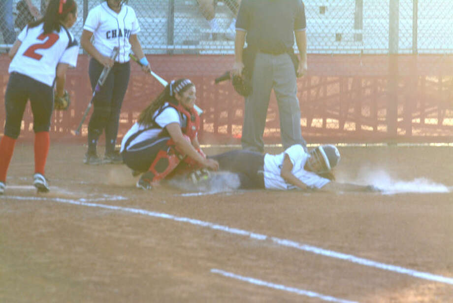 Plainview catcher Tori Magallanes tags out El Paso Chapin's Kiana Vega at home plate in the third inning of an area round playoff game in Odessa Friday. Vega tried to score from second on a single, but was thrown out at the plate by Plainview left fielder Kristan Enriquez. Photo: Skip Leon/Plainview Herald