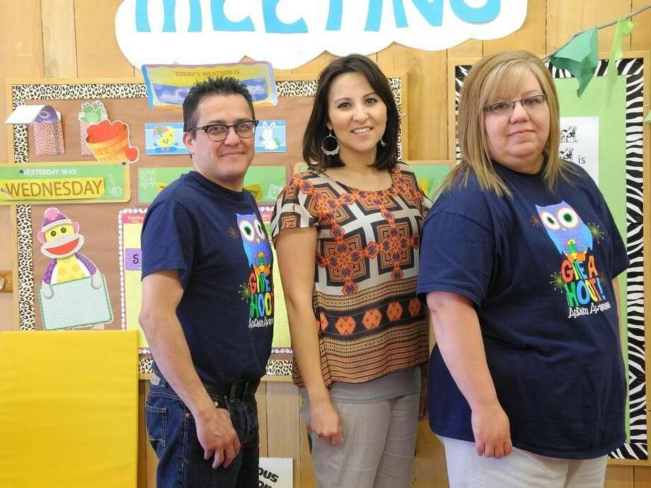 Jeff De La Garza, Student Support Services coordinator; Andrea Moreno, director of Student Support Services; and Diana Banda, administrative assistant for Student Support Services stand in the kid-friendly LEAP room in the Special Education Department. De La Garza and Banda are dressed in T-shirts designed to bring attention to Autism Awareness Month.