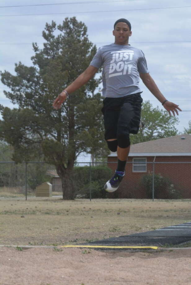 Maliek Yarbrough soars through the air as he practices the long jump this past week.The Tulia junior is seeded third in the event heading into the state meet. But he's just two inches behind the top seed. Photo: Skip Leon/Plainview Herald