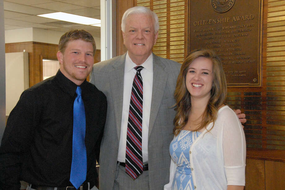 Wayland Baptist University President Dr. Paul Armes (center) stands with the 2015 Citizenship Award winners Josh Bailey, Lovington, N.M., and Nicole Adams, Amarillo, shortly after the two affixed their name plates to the commemorative plaque in the lobby of Gates Hall. The Citizenship Award is the high honor bestowed upon students by the university.