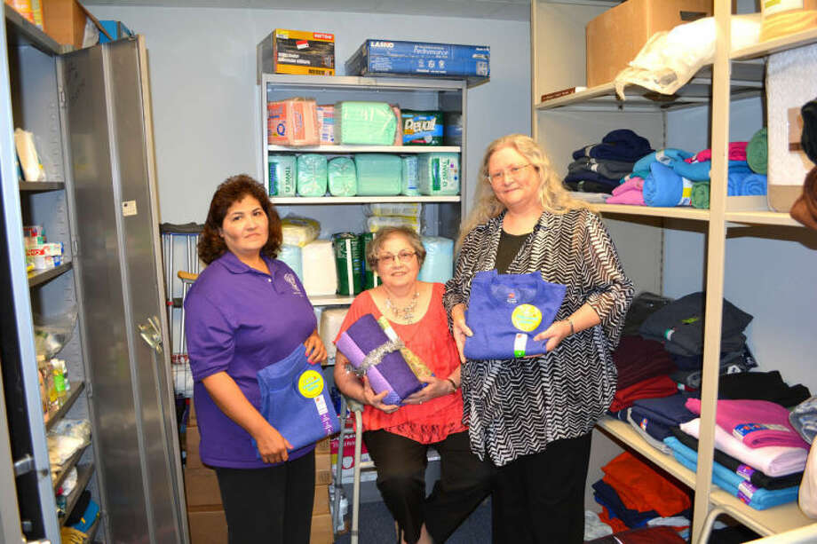 Doug McDonough/Plainview HeraldAdult Protective Services maintains a special room filled with clothing, personal hygiene items and other supplies available to caseworkers 24 hours a day, seven days a week to help clients who might be in emergency situations. Helping straighten the room are Anna Zuniga of Olton (left), Lamb County Adult Protective Services Spec. 4; Carol Schulz of Plainview, president of the Silver Star Board; and Tammy Adams of Lockney, a Silver Star Board director.