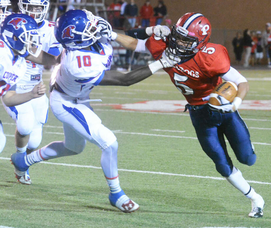 Plainview running back Warren Flye (right), shown fending off an Abilene Cooper defender to gain yardage last season, has made a verbal commitment to play football at Navarro Junior College in Corsicana. Photo: Skip Leon/Plainview Herald
