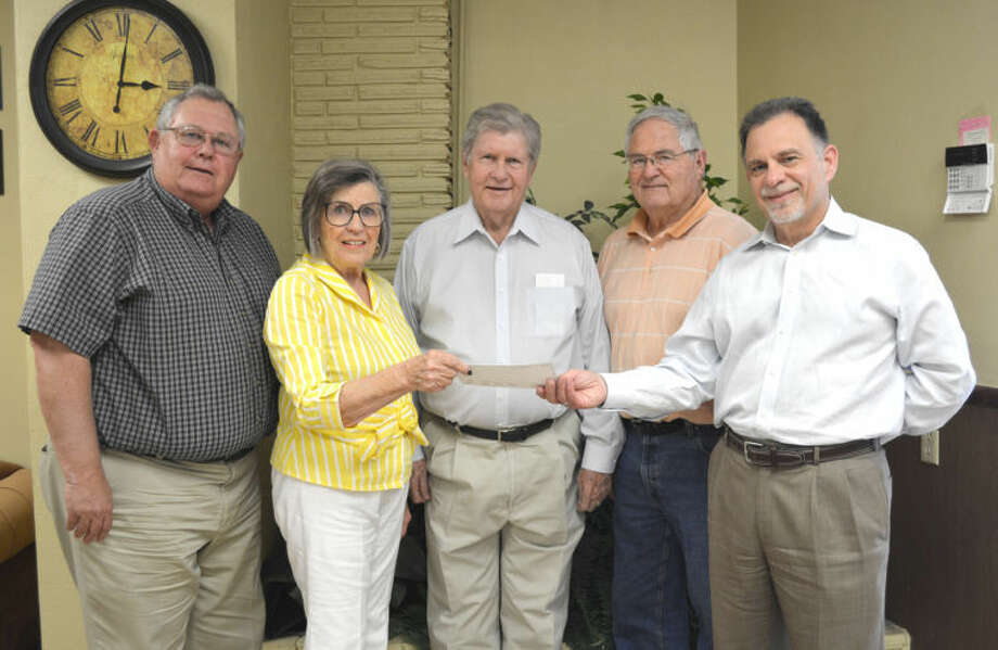 Doug McDonough/Plainview HeraldHere To Eternity, Inc. representatives Jeane Browning (center) and Ron Hanby (right) receive a check representing a $5,000 grant from the Plainview Area Endowment toward the construction of a chapel at the Formby Prison Unit. The check is being presented by Plainview Area Endowment representatives Mark Warren (left), Corky Terrell and Roy Kaiser. Here To Eternity is partnering with the Caprock Plains Baptist Area Center to raise funds for the chapel, which is expected to be completed in December. The adjacent Wheeler Unit has had a chapel for about 15 years.
