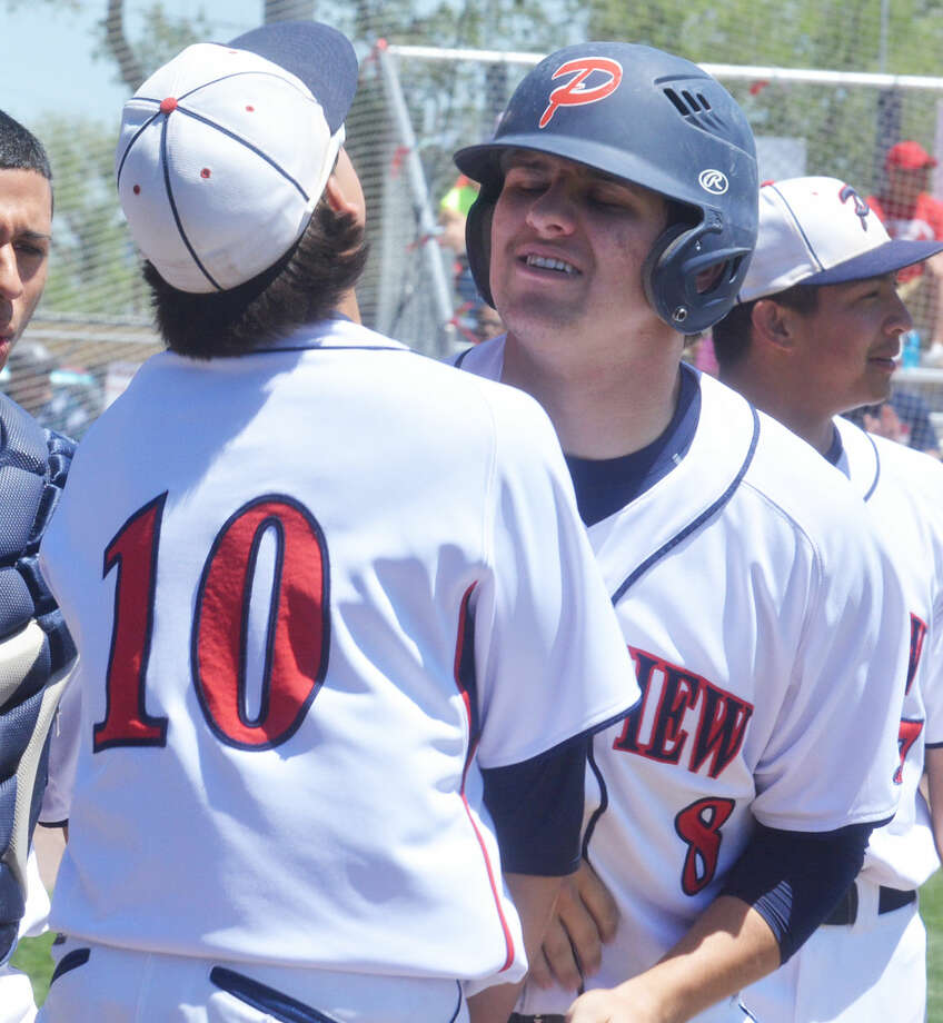 Plainview's Brent Silvas (10) congratulates Paxstyn Oldfield during a District 4-5A baseball game at Bulldog Park Saturday afternoon. The two players made it a Senior Day to remember. Silvas belted a grand slam home run and Oldfield had four hits, including two doubles an a solo home run, to lead the Bulldogs to a 13-3 triumph. Photo: Skip Leon/Plainview Herald