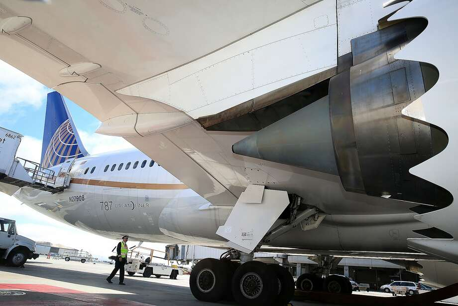 In this file photo, a United pilot does a safety check on a 787 United aircraft at SFO airport on Tuesday, July 19, 2016. Photo: Liz Hafalia, The Chronicle