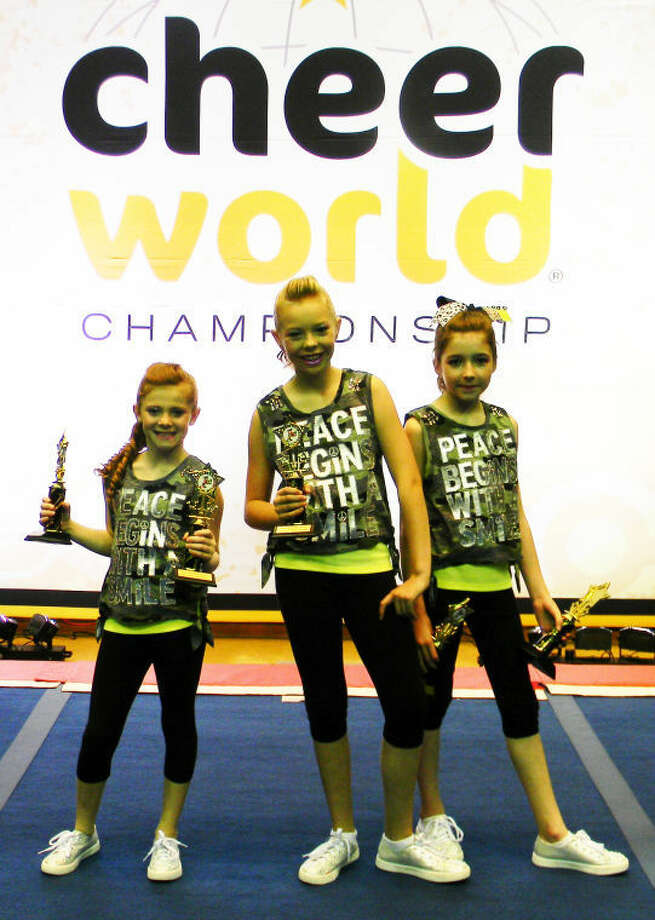 Rebel Cheer students (from left) Kamryn Gregory, Caroline Northcutt and Adri Martin won a national championship in the youth hip hop trio division at the Cheer World All-Access National Championship in Denton last month. Photo: Courtesy Photo