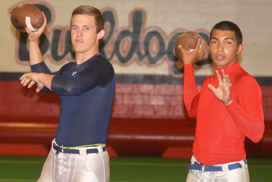 Wrangler Haresnape (left) and Marc Ramos (right) will compete for the starting quarterback job for the Plainview football team during the spring practice campaign. Spring practice began in the rain Monday and will culminate with the Blue and Red Spring Game May 21. Photo: Skip Leon/Plainview Herald