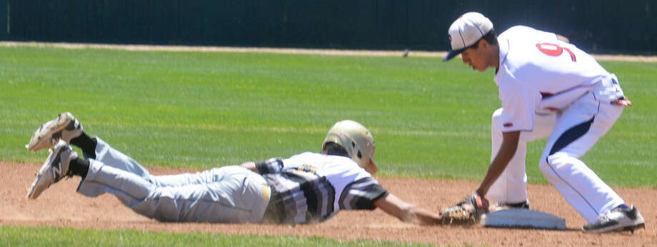 Plainview shortstop Michael Soliz applies a quick tag to a runner on a pickoff attempt at second base during a game earlier this season. The Bulldogs lost a tough 3-2 decision at Lubbock Cooper Tuesday and will finish second in District 4-5A. Photo: Skip Leon/Plainview Herald