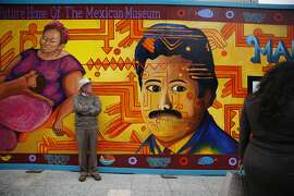 Michael Emmerson, manager forf flautist  Elena Duran, waits keeps an eye out for Duran during the Dedication Ceremony & Cornerstone Presentation for The Mexican Museum on Tuesday, July 19, 2016 in San Francisco, California.