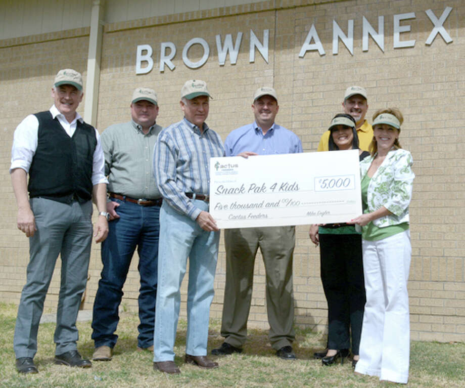 On May 1, the Plainview Snack Pak 4Kids organization was presented with a $5,000 donation from Cactus Feeders and allowed to begin using Brown Annex at Ash School for assembling the weekend packs. Pictured from left are Plainview ISD Superintendent Dr. Rocky Kirk, Hale Center Cactus Feeder President Jess Turner, Cactus Feeders CEO Mike Engler, Plainview Hale County Economic Development Corp. Executive Director Kevin Carter, Snack Pack 4Kids representative Carmen Ortega, PISD Executive Director for Administrative Services Greg Brown and LaMesa Elementary School teacher and program starter Susan Hurt.