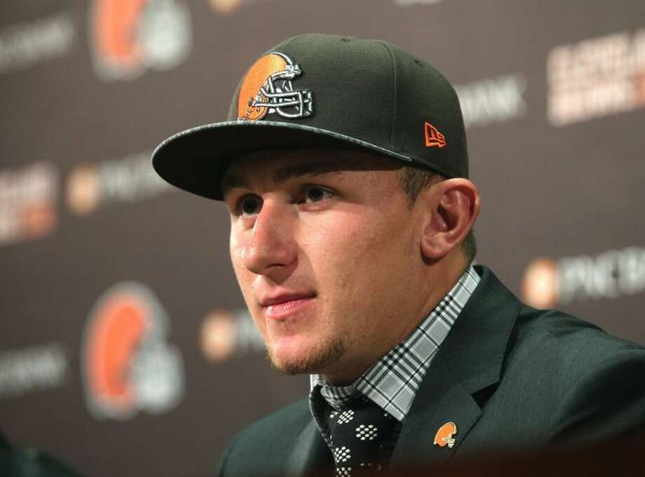 Cleveland Browns first round draft choice Johnny Manziel contemplates a question during a news conference at the team's headquarters in Berea, Ohio, Friday. Despite his celebrity and college achievements, Manziel is not guaranteed a starting job with the Browns.  Photo: Phil Masturzo/Akron Beacon Journal/MCT
