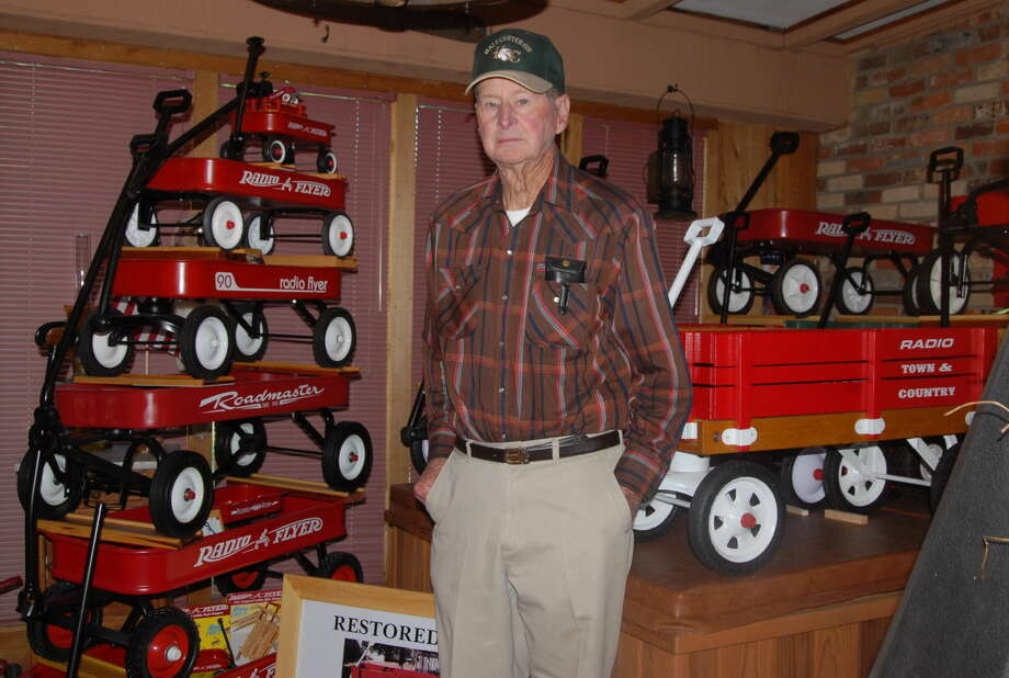 Gerald Chambers now spends his retirement restoring classic Radio Flyer wagons. His collection of the antique toys will be on display at the 23rd annual Antique Tractor Show in Hale Center Saturday. Photo: Homer Marquez/Plainview Herald