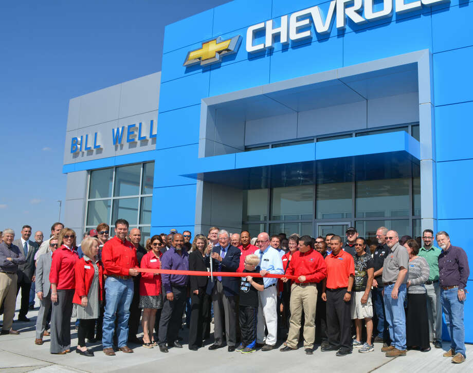 Owner Bill Wells cuts a ribbon Wednesday afternoon to formally open the new location of Bill Wells Chevrolet, 501 S. I-27. The local dealership for Chevrolet, GMC and Buick is relocating from Fifth and Joliet. The sales staff will be fully in place Saturday, May 1, with the service department opening Monday, May 3. The new 16,000-square-foot building sits on a six-acre site, and will house 24 employees. Wells has 42 years of dealership experience and has operated the local business since 2009. He plans a grand opening May 29. Wednesday's ribbon cutting was hosted by the Chamber of Commerce Ambassadors.