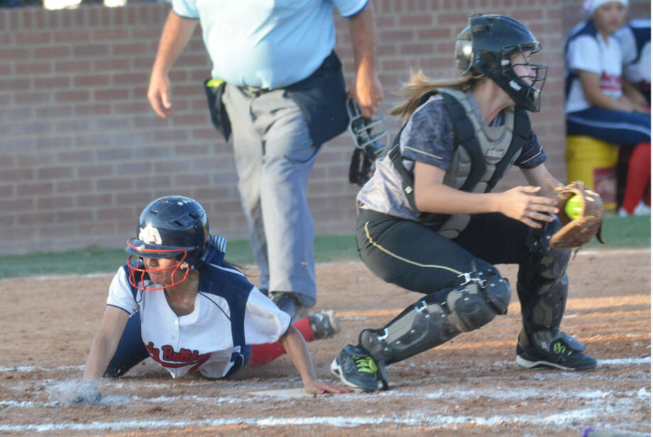 Plainview's Criselda Luna dives safely across home plate as the catcher awaits a late throw during a softball game this season. Luna, a senior, will be playing in her third postseason as the Lady Bulldogs take on Caprock in the bi-district round of the playoffs Friday and Saturday. Photo: Skip Leon/Plainview Herald