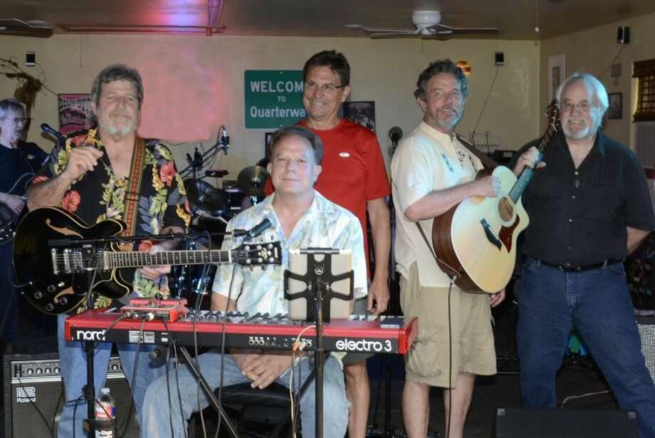 In Dripping Springs during the eighth annual Nutty Brown Spring Fling, hosted by Kenny and Van Redin, the Quarterway rock band performed for family and friends. Members of the Plainview High School Class of 1971 form the core of the six-member rock group — Van Redin, Randy Coleman and Mark Gaither, who is a native of Quarterway, a few miles west of Plainview on US 70. Before the band performed, other students from the PHS Class of 1971 joined the group onstage. From left are Mark Gaither, Van Redin (seated), Reagan Ramsower, Randy Coleman and Jim Miller. Ramsower and Redin were members of The Nail Drivin' Five, a Plainview band from the 1960s that also included 1971 graduates Richard Tunnell, Randy Culver and John David Carter.
