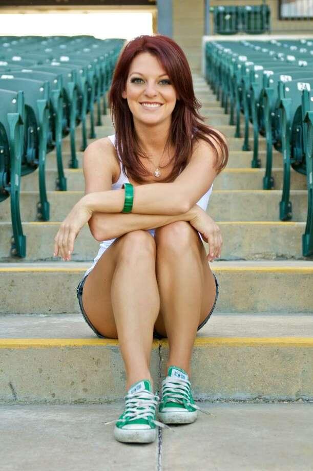 ROOT sideline reporter Julia Morales is a former University of Texas cheerleader before starting her career in broadcasting. (Julia Morales.com)