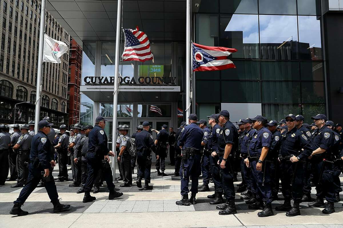"""CLEVELAND, OH - JULY 18: California Highway Patrol officers stand in formation during a """"Dump Trump"""" demonstration near the site of the Republican National Convention on July 18, 2016 in Cleveland, Ohio. Protestors are staging demonstrations outside of the Republican National Convention which starts on Monday July 18 and runs through July 21. (Photo by Justin Sullivan/Getty Images)"""