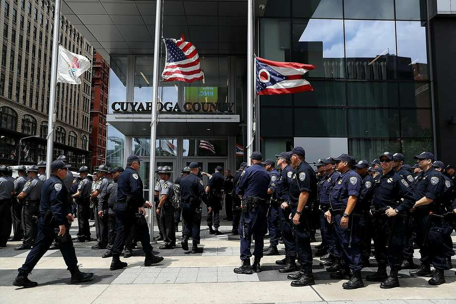 """California Highway Patrol officers stand in formation during a """"Dump Trump"""" demonstration near the site of the Republican National Convention on July 18, 2016 in Cleveland. Photo: Justin Sullivan, Getty Images"""