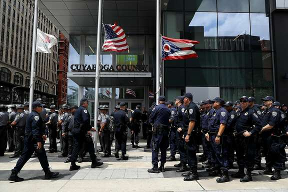 "CLEVELAND, OH - JULY 18:  California Highway Patrol officers stand in formation during a ""Dump Trump"" demonstration near the site of the Republican National Convention on July 18, 2016 in Cleveland, Ohio. Protestors are staging demonstrations outside of the Republican National Convention which starts on Monday July 18 and runs through July 21.  (Photo by Justin Sullivan/Getty Images)"