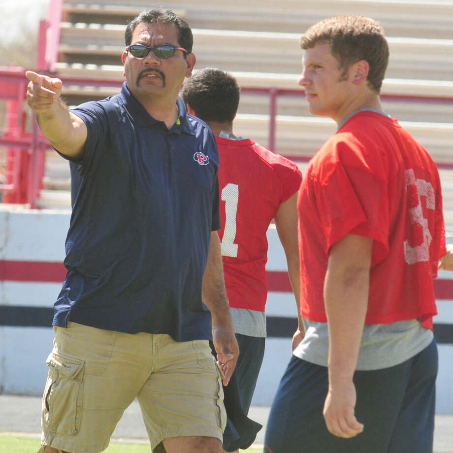 Marcos Hinojos (left) makes a point to Dakota Crawford during 2013 spring football when he was the head coach of the Bulldogs. The former PHS coach is returning to Plainview to coach linebackers for the Wayland Baptist University football team. Photo: Skip Leon/Plainview Herald