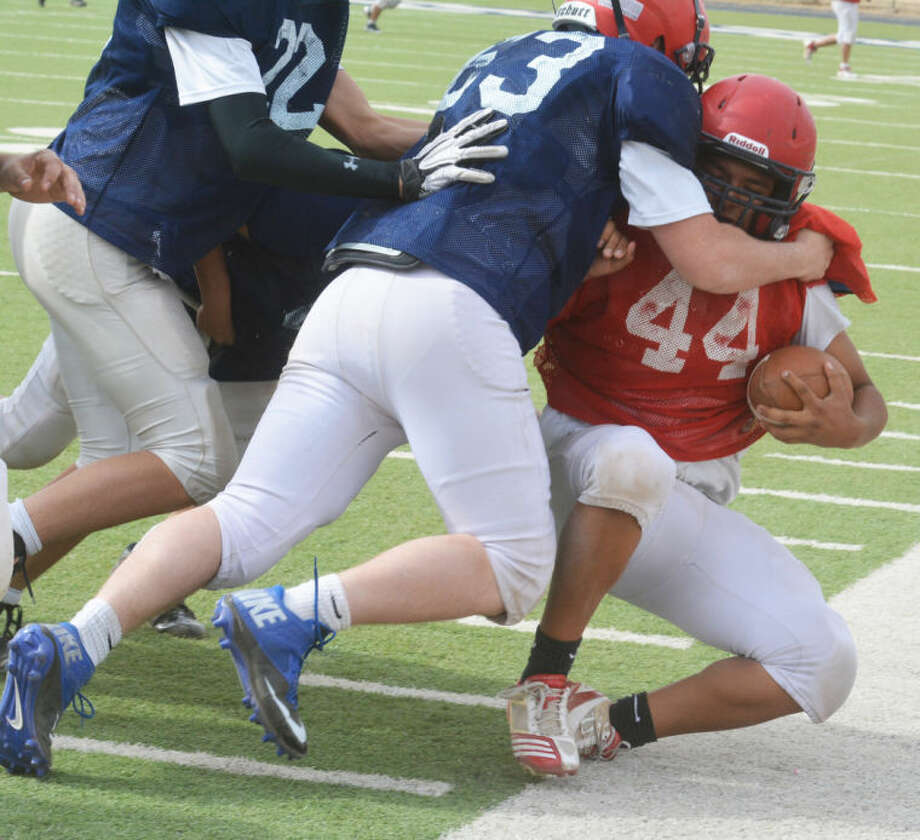 Plainview defensive players swarm a ballcarrier during a spring football practice. The spring campaign will culminate with the Red/White Spring Game at 6 p.m. Thursday at Greg Sherwood Bulldog Memorial Stadium. Photo: Skip Leon/Plainview Herald