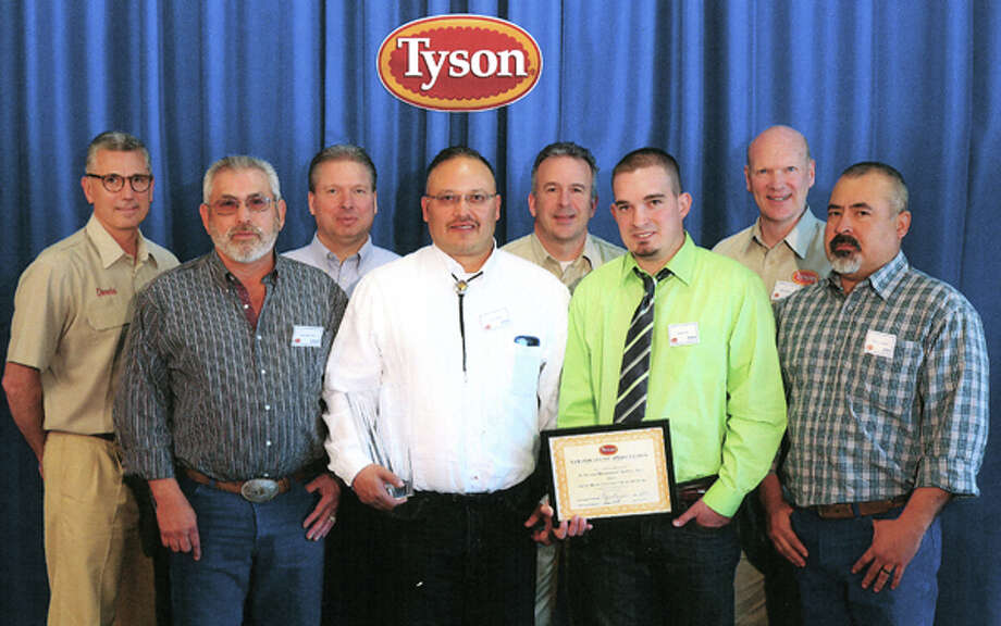 Courtesy PhotoHi-Plains Millwright representatives Jesse Martinez (front left), Larry Gloria, Daniel Vail and Ramiro Lazcano receive Supplier of the Year recognition from Tyson Food representatives Donnie Smith (back left) CEO, Todd Hansen, Craig Bacon and Mike Roetzel.