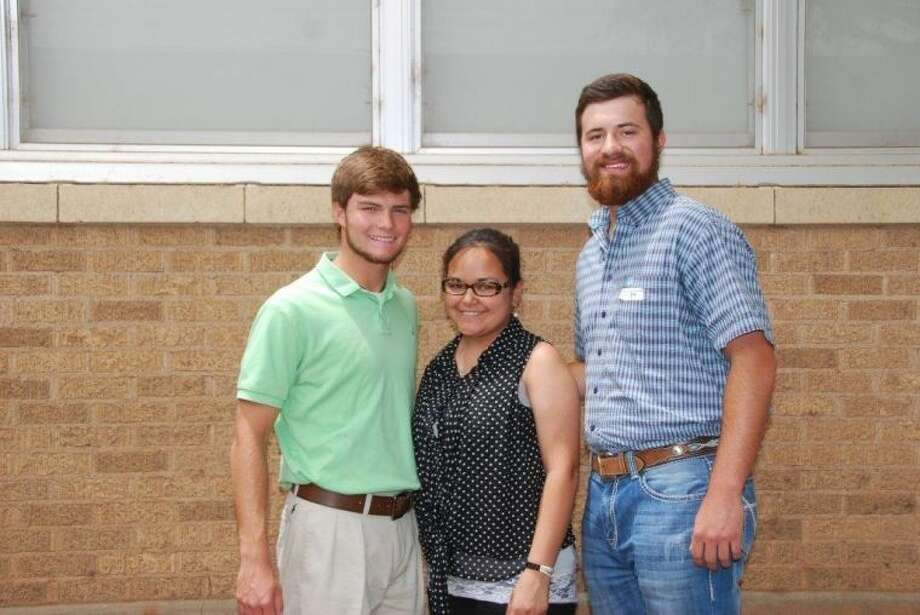 Courtesy photoHighland PTA President Joni Perez (center) presents Highland PTA's Jacob Chapa Memorial Scholarships to PHS seniors Thomas Wirth (left) and Jacob Richburg. The scholarships, $500 each, are given annually to former Highland students.