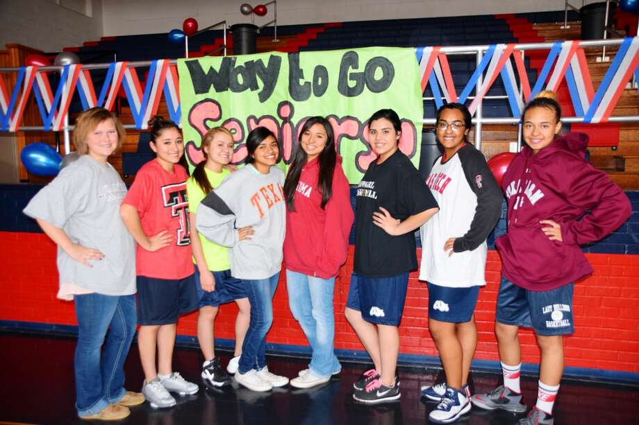 PHS freshmen Emily White (left) Gaby Garza, Allyson Solis, Samantha Gonzales, Jaiden Salas, Jaylynn Galvan, Zsanayia Lopez and Aaliyah Washington display college T-shirts in support of GenTX Decision Day on Tuesday. Currently, 90 percent of the PHS Class of 2015 has been accepted into a postsecondary education program. All students, staff and members of the community are encouraged to wear T-shirts with university logos Tuesday in support of higher education.