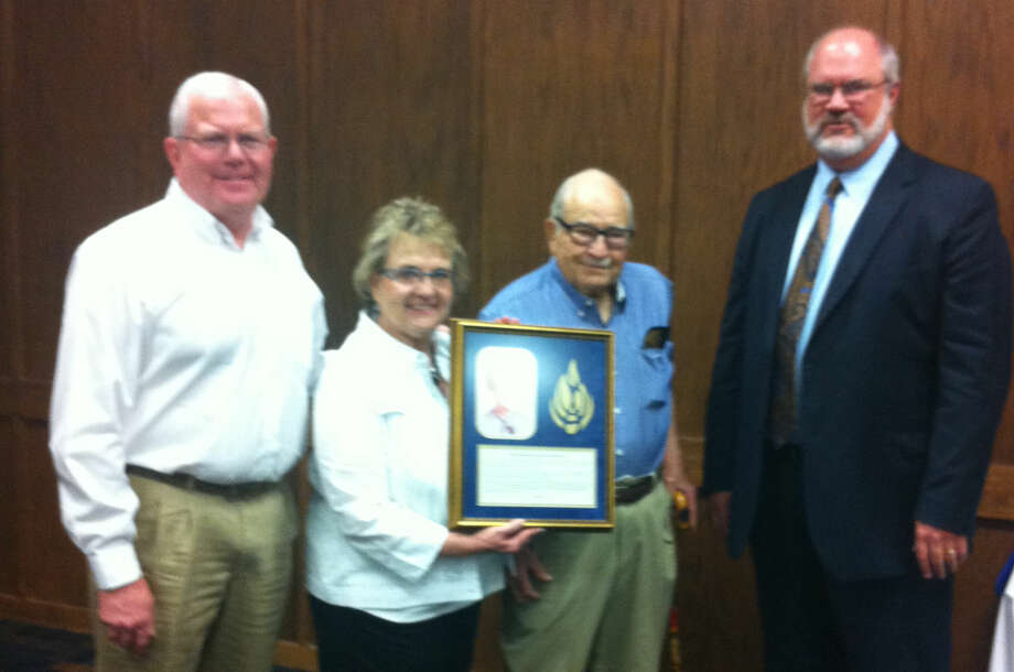Mike Melcher/Wayland Baptist UniversityDr. Harold Reese (center) and his children, Dr. Hal Reese of Decatur (left) and Sheryl Reese of Santa Fe, show off the shadow box marking the scholarship in their wife and mother's memory. Dr. Claude Lusk, vice president for enrollment management, represented WBU administration at the dedication ceremony.