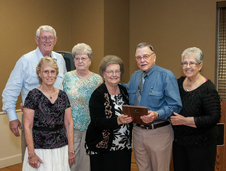 Abernathy Man of the Year Courtesy Photo/Abernathy Chamber of Commerce Ray Naron (second from right) receives his plaque as Abernathy Man of the Year from Abernathy Mayor Pro-Tempore Sharon Kester-Fair. Joining him for the presentation at the Abernathy Chamber of Commerce Banquet on Monday are brother Adron Fisher and his wife Carolyn, sister Carrolyn Pinson (front left) and Naron's wife Ruth (far right).
