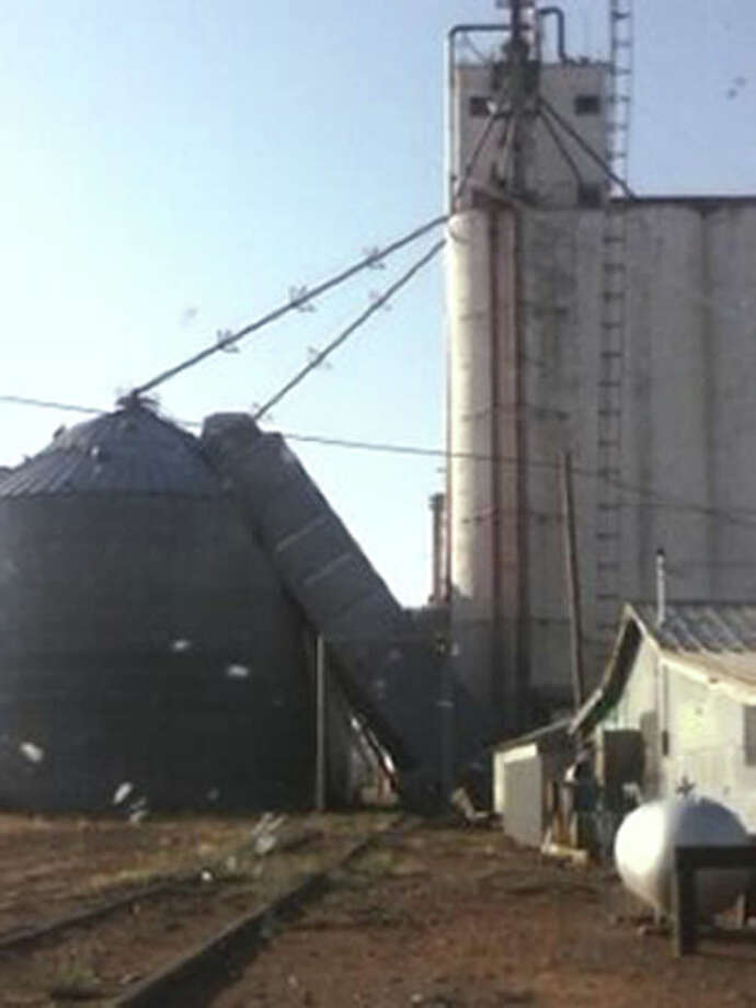 A storm that pushed through Hart shortly before 7 p.m. Wednesday pushed a grain drier against a metal silo at the Northern Ag elevator in Hart in this scene captured by Herald carrier Salvador Arteaga. Several residents in the area report that damage was caused by a tornado, although it has not been confirmed by the National Weather Service.