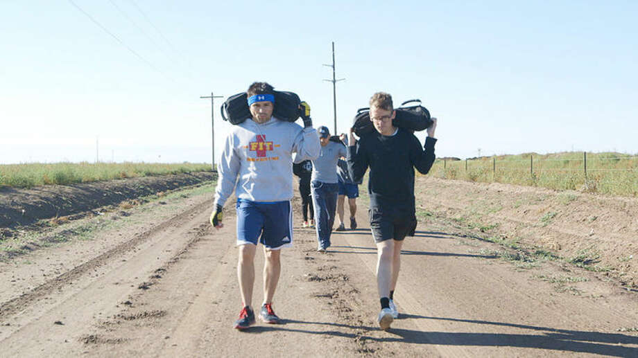 "Plainview detective Manual Balderes walks with Vice reporter Thomas Morton during the filming of the episode ""Deliver us from Drought"" set to air on HBO next Monday. Photo: HBO Photo"