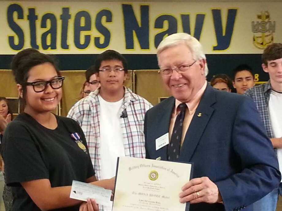 Courtesy PhotoNavy Capt. Charles Starnes (ret.) presents the Military Officers Association of America's JROTC Medal to Cadet Lt. Cynthia Luna of Plainview High's Navy JROTC unit on Thursday. The presentation came during the unit's field day.