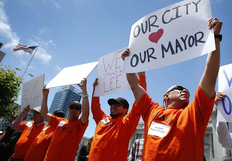 Paolo Martinez (right) and other union members rally in July to oppose recalling Mayor Ed Lee. Photo: Paul Chinn, The Chronicle