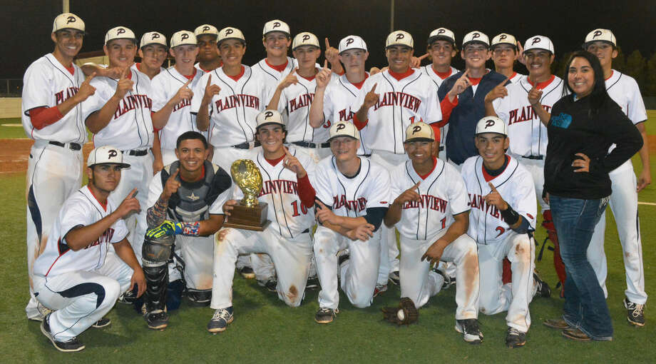 The Plainview Bulldogs baseball team takes time out to pose with the bi-district championship trophy they earned Friday night. Photo: Skip Leon/Plainview Herald
