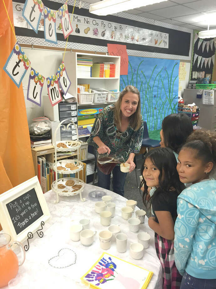Mother's Day TeaCourtesy photoThunderbird kindergarten teacher Christy Anderson and her students prepare tea and cookies to honor their mothers with a Mother's Day Tea on Friday afternoon.