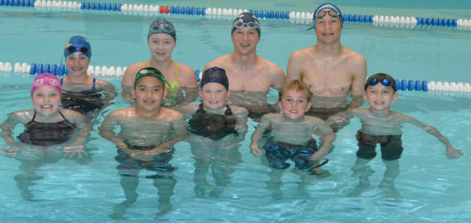 Members of the YMCA Aquatics Club swim team are front row (from left) Miranda McIlroy, Ivan Torres, Haley Curtis, James McLaurin and Rory Reed. Back row (from left) Hannah Massingill, Megan Harp, Travis Heinen and Joshua Heinen. Not pictured are Olivia Grubser and Achilies Melendez. Photo: Skip Leon/Plainview Herald
