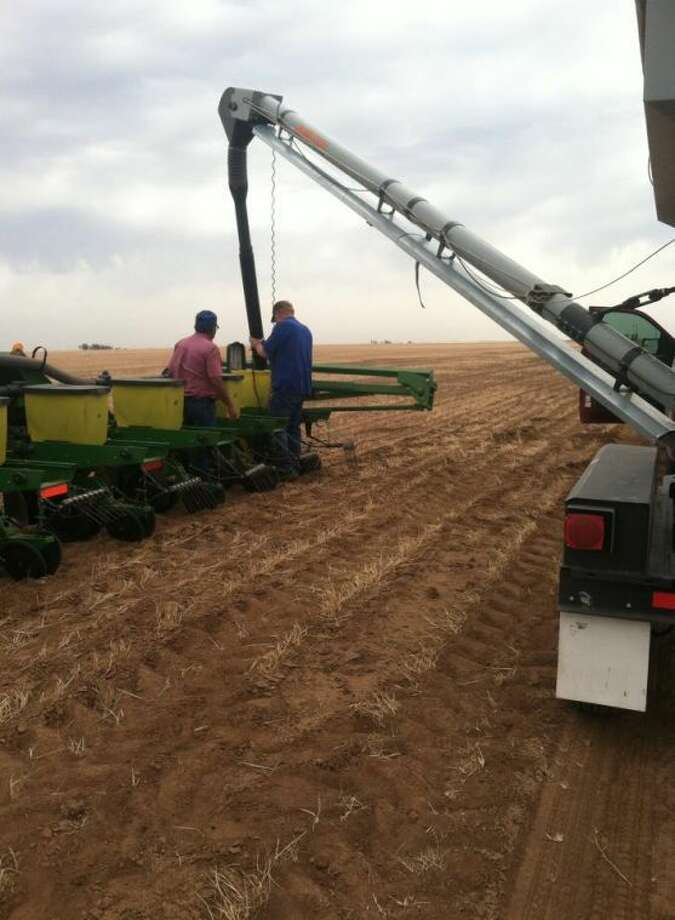 Courtesy Photo/Lesca DurhamMore than 50 volunteers helped plant 1,000 acres of cotton for an ailing Floyd County farmer and his family.
