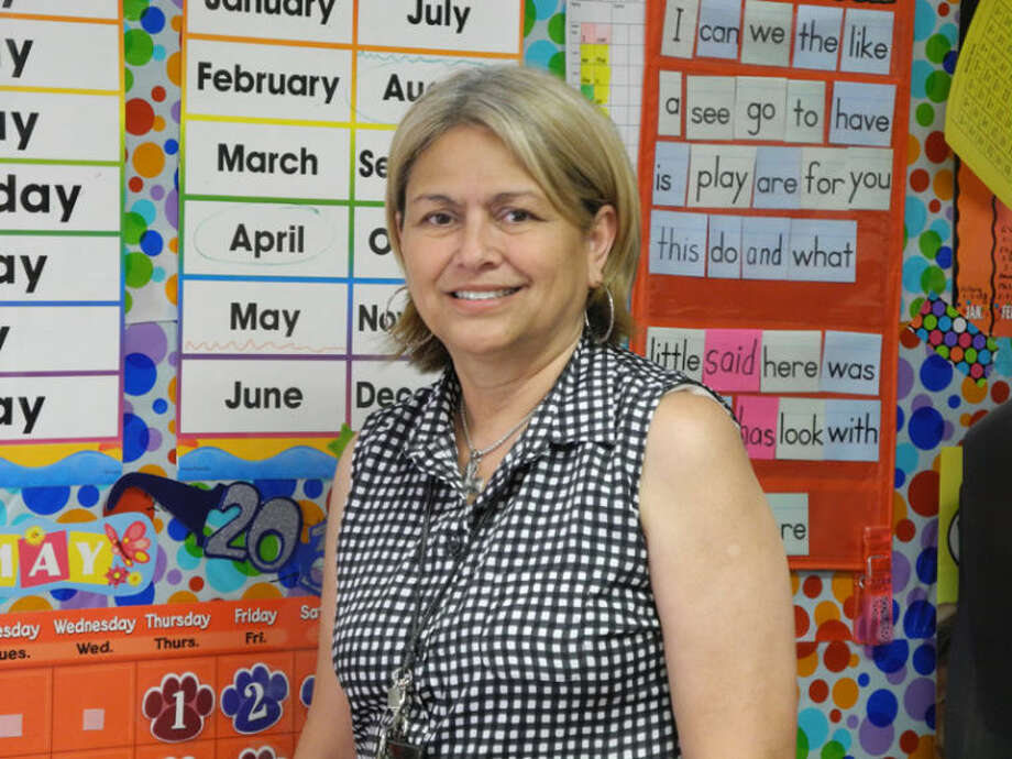 Carmen Perez, 20-year bilingual kindergarten teacher, in her classrom Photo: Gail M. Williams | Herald Lifestyles Editor