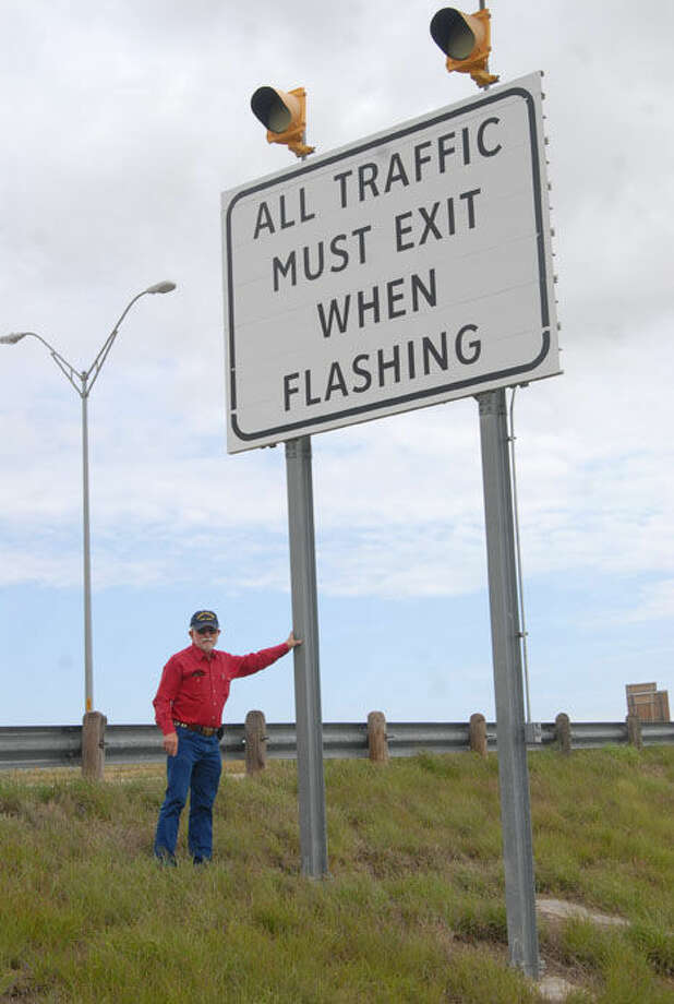 Homer Marquez/Plainview HeraldHale Center Fire Chief Ron Groves stands next to a flood warning sign on I-27, designed to tell motorists to exit when flood waters are near.Officials warning motorists not to ignore the signs