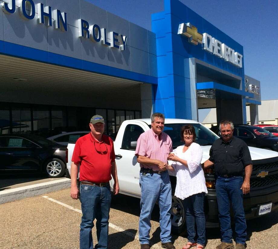 Rainbow WinnerCourtesy PhotoDonna Kay Burnett of Plainview, winner of the 2015 Rainbow Room Truck Raffle, accepts keys to a new Chevrolet Silverado pickup from John Roley of Johny Roley's Auto Center in Littlefield and Sales Manager Jason Wood. Her husband, Vondell Burnett, is at left. Burnett's winning ticket was drawn during a Plainview Lions Club meeting. The annual raffle supports Plainview's Rainbow Room, which is an emergency resource center available to Child Protective Service caseworkers to help them meet the critical needs of abuse and neglected children.