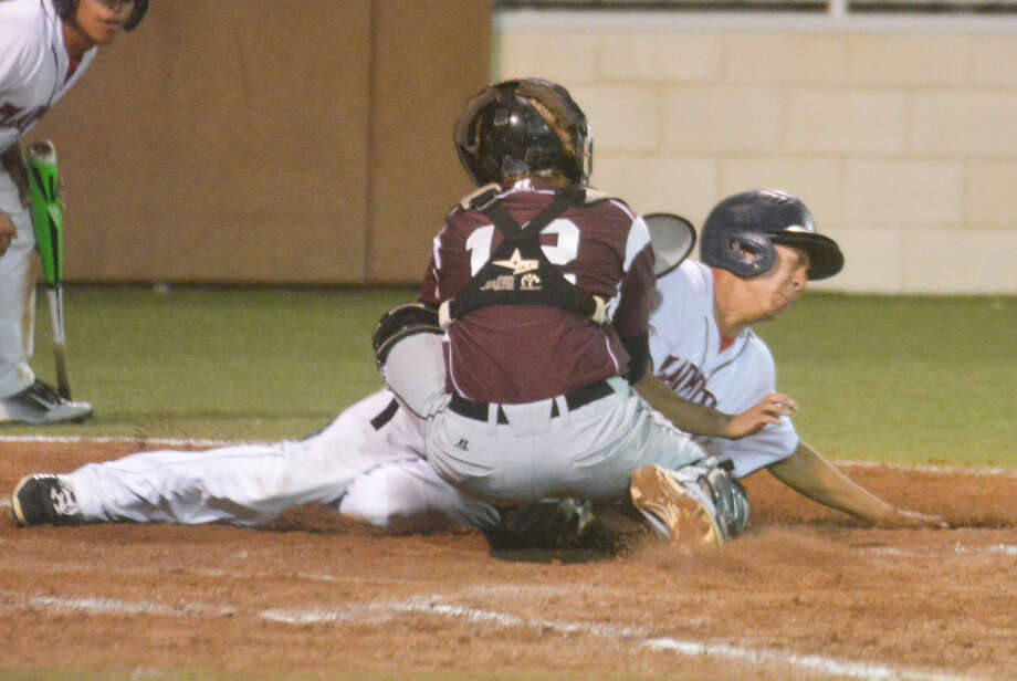 Plainview's Brennan Carreon slides hard into home plate as Hereford catcher Trace Kapka, 12, tags him during the bi-district round of the playoffs last week. The Bulldogs take on El Paso Burges in the area round Friday and Saturday at Christiansen Stadium in Midland. Photo: Skip Leon/Plainview Herald