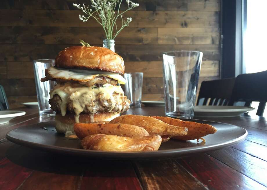 "Bexar Pub from the Folc retsaurant team has opened on Brooklyn Avenue. It's alcohol only for now, but the celebrated brisket burger from Folc will be coming to Bexar Pub when the kitchen's up and running ""in a couple of weeks,"" the pub said on Facebook. Photo: Edmund Tijerina"