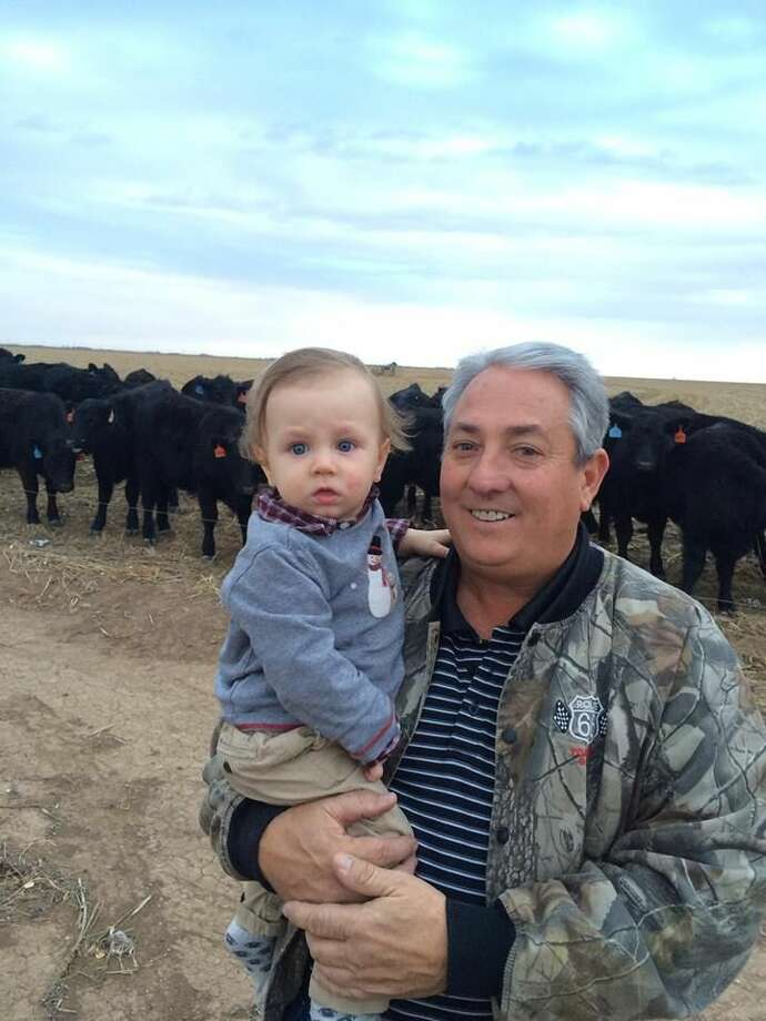 Holding his grandson Slade, Darren Young has farmed the South Plains for more than 30 years. Photo: Courtesy Photo