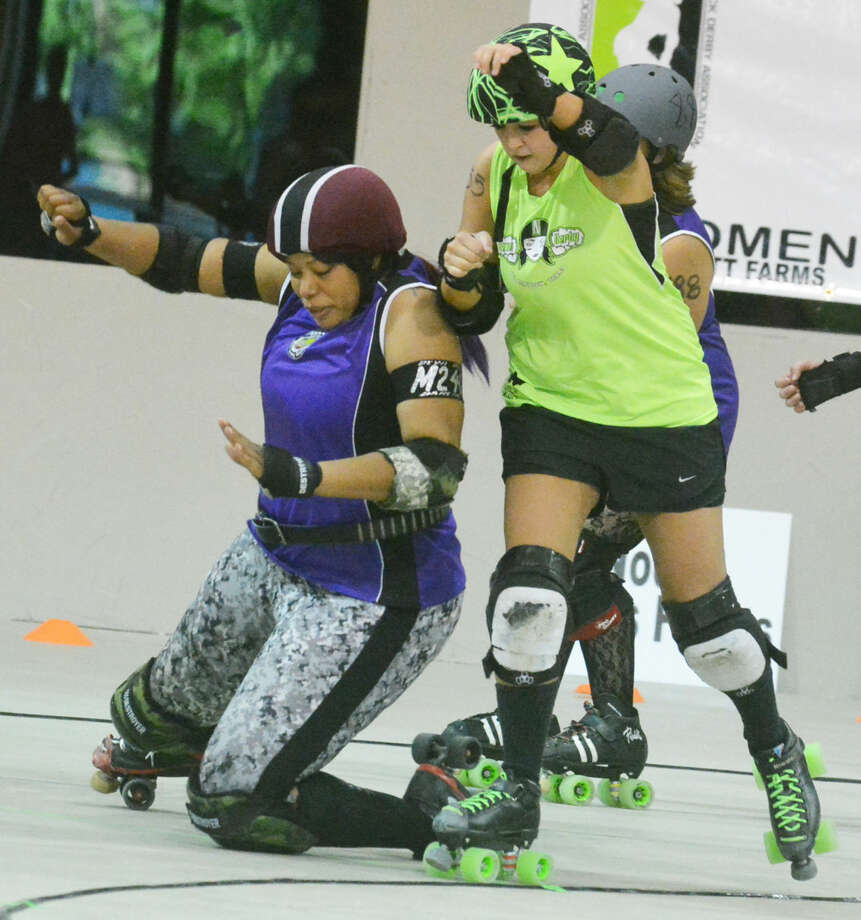 There was plenty of action during the first Roller Derby match in Plainview last year. Roller Derby returns to Plainview Saturday when the local 'Down 'N' Derby team hosts the West Texas Dollz at 7 p.m. at Ollie Liner Center. Photo: Skip Leon/Plainview Herald