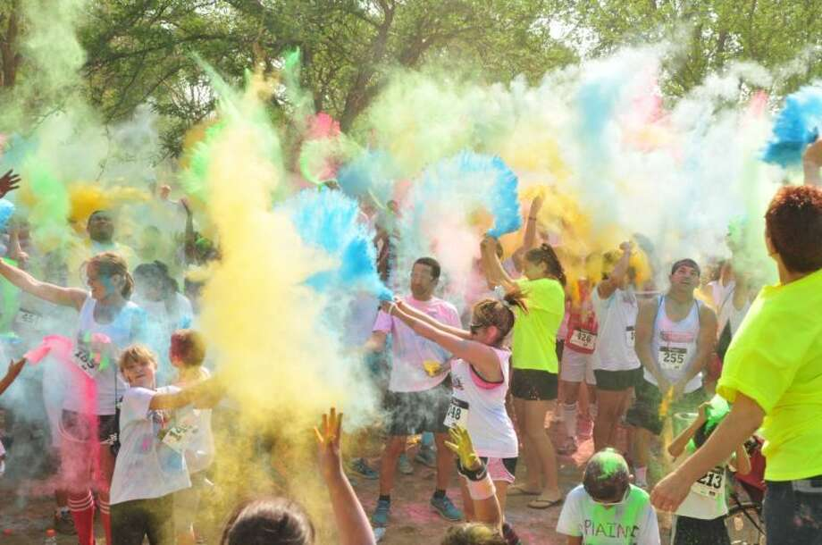 Participates in the 2013 Color Fun Freedom Run fill the air with color during the Plainview Crime Stoppers' inaugural event last July. Photo: Herald File Photo