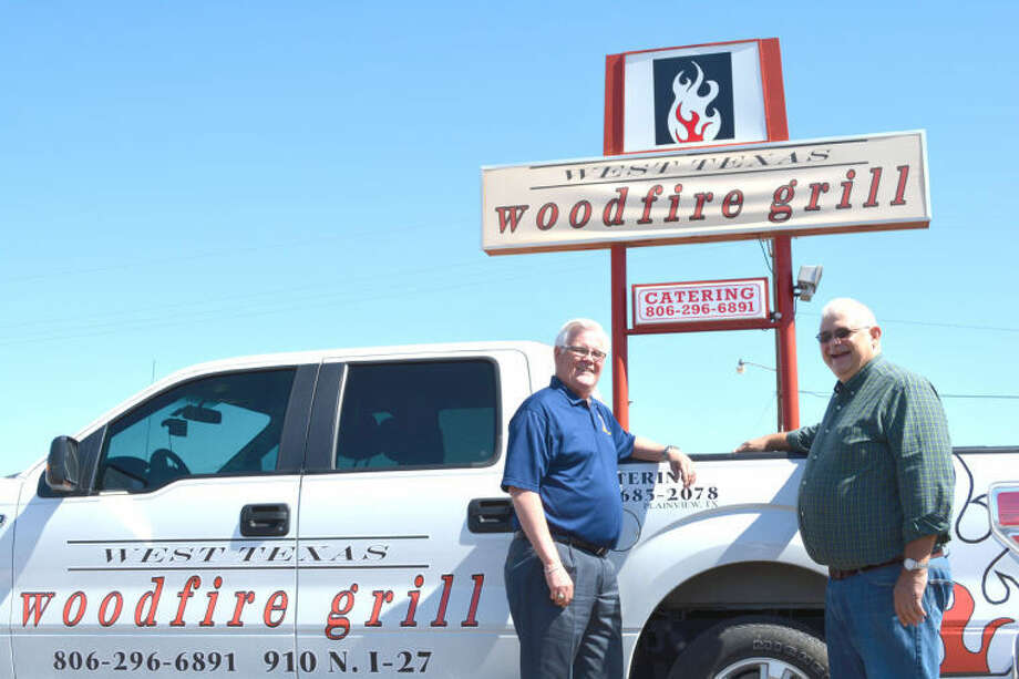 Doug McDonough/Plainview HeraldChamber of Commerce Business Promotion Chairman Danny Andrews (left) and business owner Glenn Dillard pause while planning Thursday's Business After Hours mixer, set for West Texas Woodfire Grill, 910 N. I-27. The open house will run from 5-6:30 p.m. Thursday and feature music, door prizes and refreshments. The restaurant is owned and operated by Glenn and Coralyn Dillard, and the Business After Hours Mixer marks its fourth anniversary. It is open to Chamber members as well as the local business community and general public.