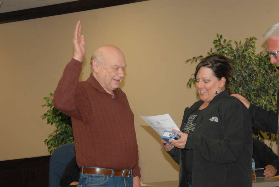 On Thursday, Election Judge Christina Salazar swears in incumbent Ron Warren, who won the May 9 election for the District 5 school board seat. Photo: Homer Marquez/Plainview Herald